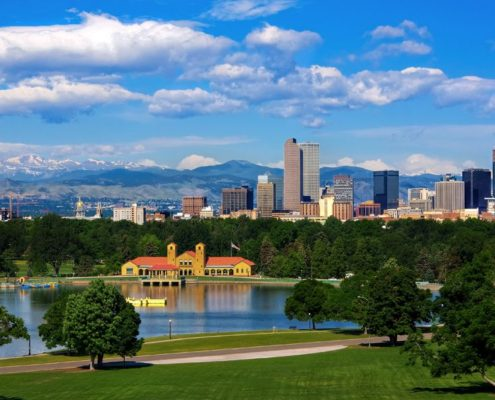 This photo of downtown Denver with the Colorado Rocky Mountains in the background and Wash Park in the foreground is the navigation button for Denver Area Alternative Therapy Facility Listings on The Body Is Mind website. Select this button to navigate to that page.