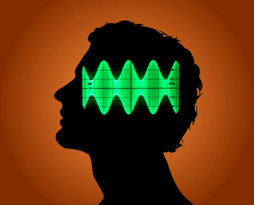 a sillouhette of a head with superimposed sinewaves from an oscilloscope used on the brainwave entrainment article of the Ultimate Healing Guide