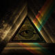 this image depicts the eye of providence inside a triangle prism with a rainbow of light in space and is used for the meditation article on the Ultimate Healing Guide - The Body Is Mind