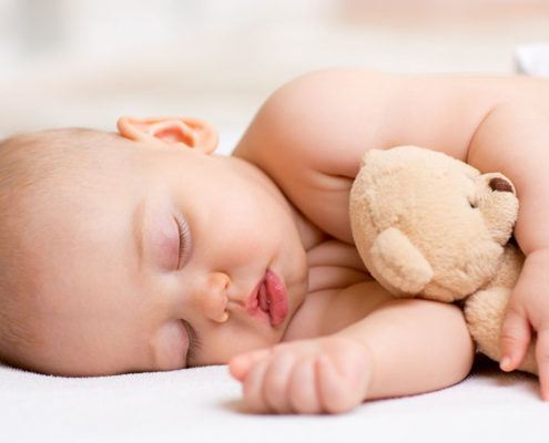 This image of a baby sleeping is used on the body is mind ultimate healing guide article on proper sleep