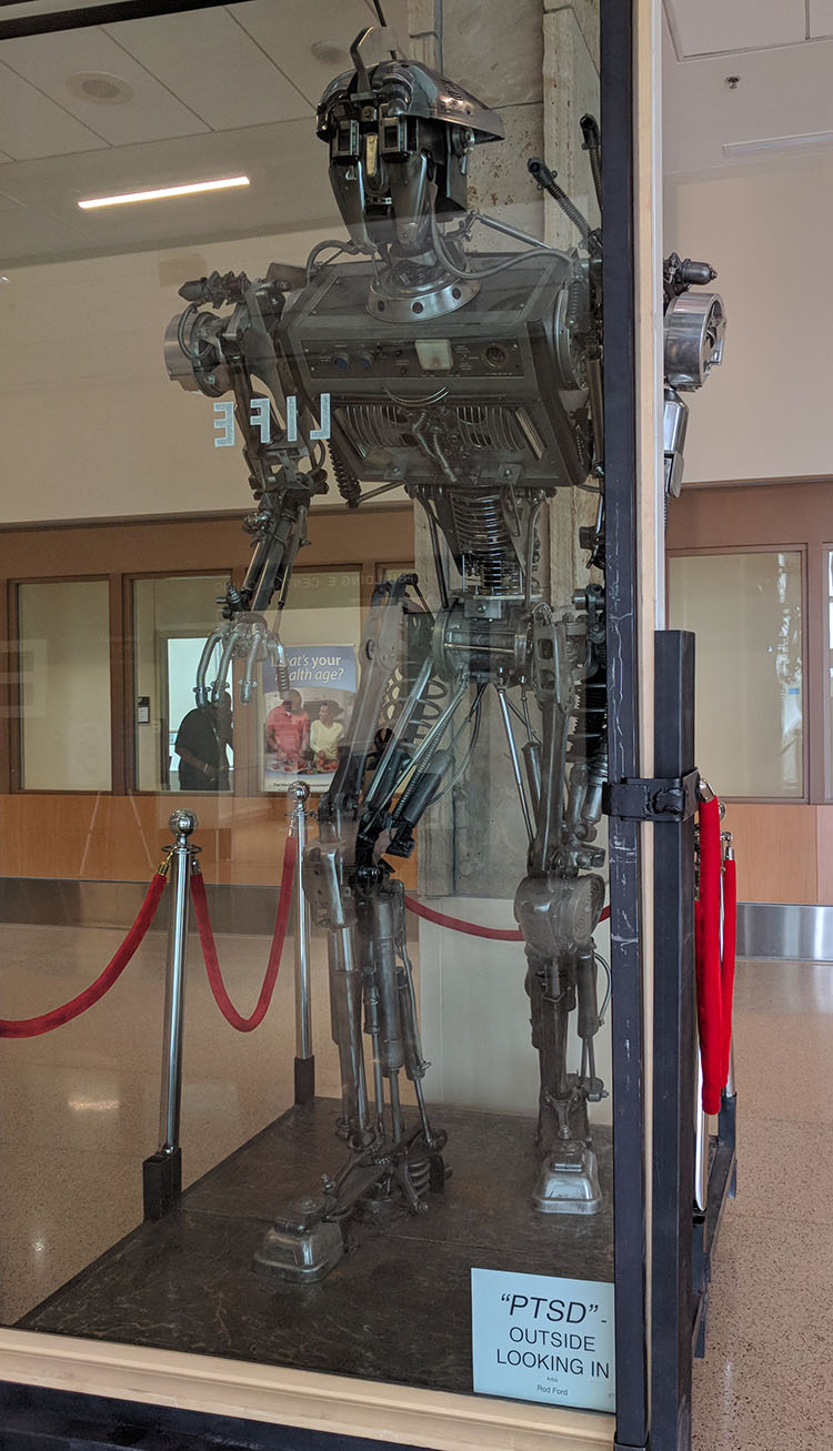 Giant Robot Art at the VA Rocky Mountain Regional Medical Center in Colorado - PTSD - Outside Looking In by Rod Ford